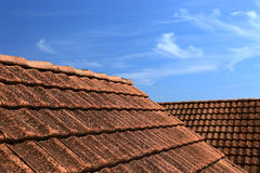 Tiled roof and blue sky. Old tiled roof and beautiful blue sky. Abstract photo as background or backdrop Royalty Free Stock Images