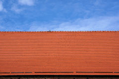 Tiled roof and blue sky background. Stock Image