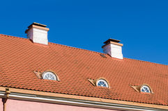 Tiled roof with chimneys and mansard windows Royalty Free Stock Photography