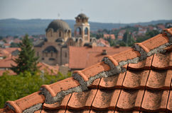Tiled roof and church Stock Photography