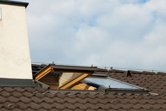 Tiled roof and dormer windows Stock Images