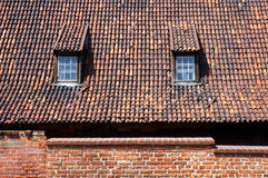Tiled roof with dormers in Gdansk, Poland. Royalty Free Stock Photos