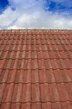 Tiled Roof with Fluffy Cloud Blue Sky Stock Photo