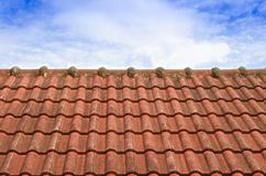 Tiled Roof with Fluffy Cloud Blue Sky Stock Images