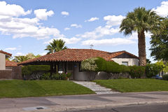 Tiled roof and palm trees neiborhood home. Stock Image
