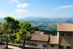 Tiled roof and a panoramic view from the walls of San - Marino, Stock Image