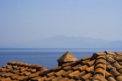 Tiled Roof by the Sea, Monemvasia - Greece. View of the Aegean Sea from the tiled roof of a house at Monemvasia, Peloponnese - Greece Royalty Free Stock Image