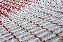 Tiled roof with snow powder Royalty Free Stock Images