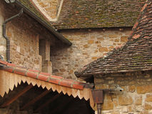 Tiled  roof and stone wall of the cloister Stock Photo