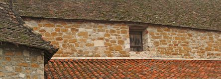 Tiled  roof and stone wall of the cloister Royalty Free Stock Photo