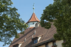 Tiled roof with tower Stock Photography
