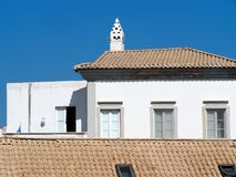 Tiled Roof With White Buildings In Faro Portugal. Tiled roofs with white buildings against a blue sky in Faro Portugal stock photography