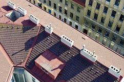 Tiled roof with white chimneys Royalty Free Stock Photography
