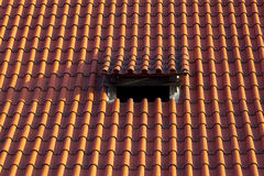 Tiled roof with window Stock Image