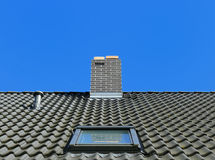 Tiled roof with window Stock Photo