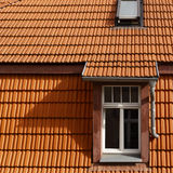 Tiled roof and windows Stock Images