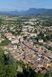 The tiled roofs of Crest and mountain landscape. In Drome Region in South of France royalty free stock photo
