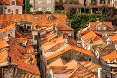 The Tiled Roofs of Dubrovnik. Tiled roofs seldom tell such a vivid story as they do in Dubrovnik, Croatia.  Stories of war.  Stories of reconstruction.  The war Stock Photos