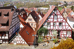 Tiled roofs of half-timbered houses of old city. HERRENBERG, GERMANY - APRIL 19, 2015: Panoramic view. Tiled roofs of half-timbered houses of old city. Baden Stock Photos