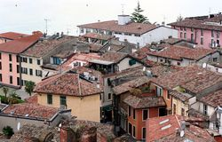 Tiled roofs of italian resort Sirmione Stock Images