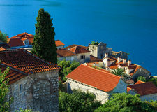 Tiled roofs of Perast city. Kotor bay, Montenegro Stock Image