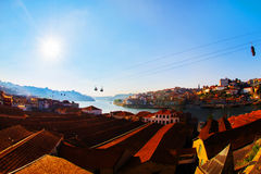 Tiled roofs in Porto. The Douro River. Summer city landscape. Stock Photos