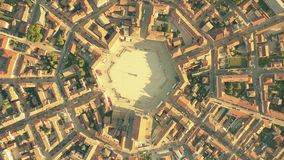 Tiled roofs of symmetric Palmanova town. Aerial top down view of the hexagonal square in the center of Palmanova stock footage