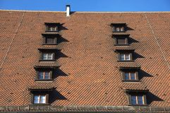 Tiled Rroof. A german tiled roof with many windows royalty free stock photo