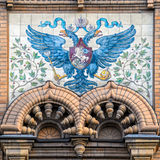 Tiled Russian two-headed eagle. SAINT PETERSBURG, RUSSIA - October 20, 2016: Tiled majolica Russian two-headed eagle coat of arms with a rider on board - a stock photo