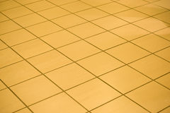 Tiled shop floor: background pattern. Royalty Free Stock Image