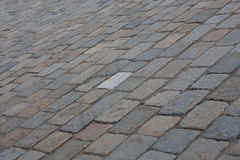 Tiled street with one odd tile Royalty Free Stock Images