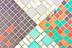 Tiled surface. Part of a patterned tiled surface which is weathered and dusty Royalty Free Stock Photo