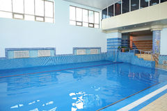 Tiled swimming pool with blue water. Fitness center's tiled swimming pool with blue water Stock Photo