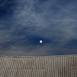 Tiled top of the roof and cloudy blue sky Royalty Free Stock Images