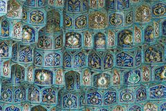Tiled wall. Fragment of a tiled wall with Arabic mosaic of an ancient mosque in Saint Petersburg, Russia royalty free stock photography