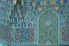 Tiled wall. Fragment of a tiled wall with Arabic mosaic of an ancient mosque in Saint Petersburg, Russia royalty free stock photos