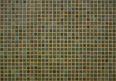 Tiled wall background in shades of green. Exterior wall with green tiles in geometric pattern royalty free stock photos