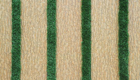 Tiled wall with green grass Royalty Free Stock Image
