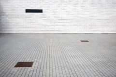 Tiled wall and paving. Tiled wall with a blank white bricks and paving Royalty Free Stock Photography