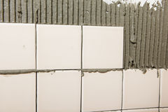 Tiled wall in process royalty free stock image