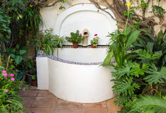 Tiled well or fountain in courtyard in Cordoba Spain Stock Photos