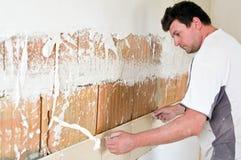Tiler. A tiler at work, putting new tiles on the wall Royalty Free Stock Photos