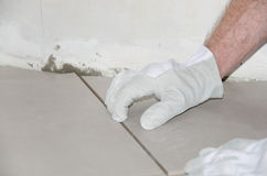 Tiler adjusting a tile Royalty Free Stock Photography