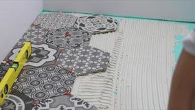 Tiler applying tile adhesive on the floor. Tiler applying tile adhesive on the bathroom floor stock video footage