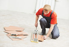 Tiler cutting tile at home renovation work Royalty Free Stock Images