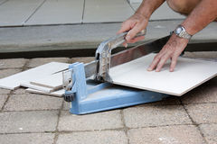 Tiler cutting tiles Stock Photos