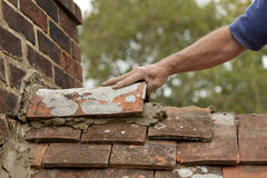 Tiler Fits Ridge Tile On Roof Royalty Free Stock Image