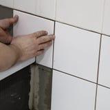 Tiler fitting tiles Stock Images
