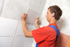 Tiler at home renovation work Stock Photos