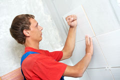 Tiler at home renovation work Stock Photo